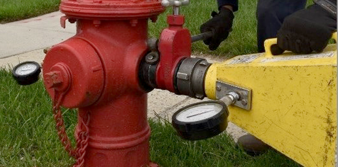 Fire hydrant being flushed
